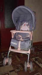 Прогулочная коляска для девочки